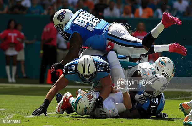 Ryan Tannehill of the Miami Dolphins is tackled after a pass during a game against the Tennessee Titans on October 9 2016 in Miami Gardens Florida