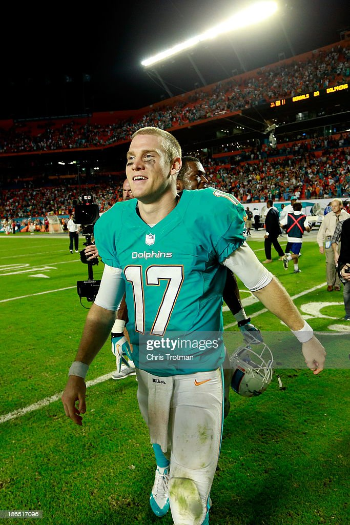 <a gi-track='captionPersonalityLinkClicked' href=/galleries/search?phrase=Ryan+Tannehill&family=editorial&specificpeople=5573174 ng-click='$event.stopPropagation()'>Ryan Tannehill</a> #17 of the Miami Dolphins leaves the field following his teams victory over Cincinnati Bengals at Sun Life Stadium on October 31, 2013 in Miami Gardens, Florida.