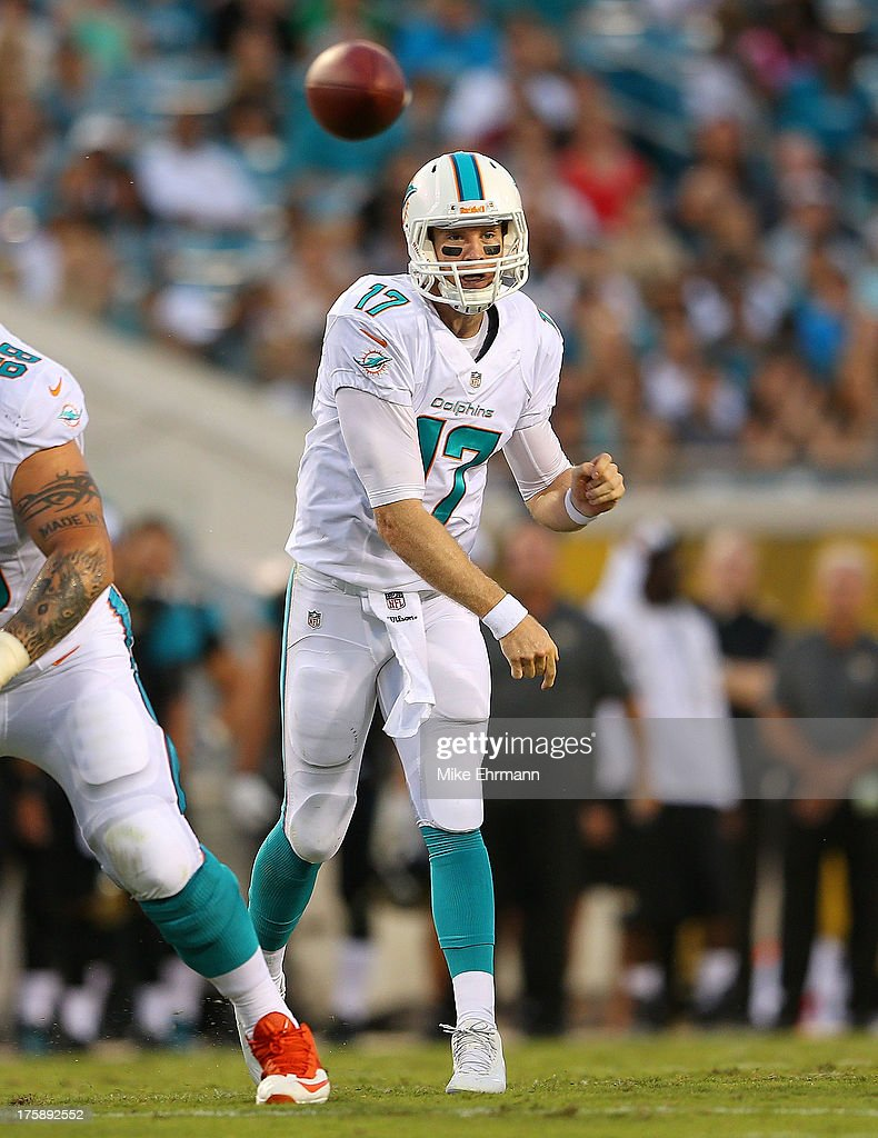 <a gi-track='captionPersonalityLinkClicked' href=/galleries/search?phrase=Ryan+Tannehill&family=editorial&specificpeople=5573174 ng-click='$event.stopPropagation()'>Ryan Tannehill</a> #17 of the Miami Dolphins passes during a preseason game against the Jacksonville Jaguars at EverBank Field on August 9, 2013 in Jacksonville, Florida.