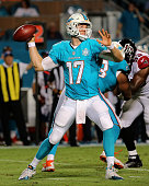 Ryan Tannehill of the Miami Dolphins passes during a preseason game against the Atlanta Falcons at Sun Life Stadium on August 29 2015 in Miami...