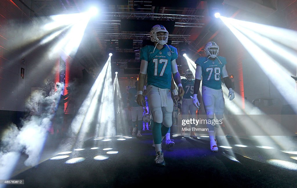 <a gi-track='captionPersonalityLinkClicked' href=/galleries/search?phrase=Ryan+Tannehill&family=editorial&specificpeople=5573174 ng-click='$event.stopPropagation()'>Ryan Tannehill</a> #17 of the Miami Dolphins takes the field during a preseason game against the Atlanta Falcons at Sun Life Stadium on August 29, 2015 in Miami Gardens, Florida.