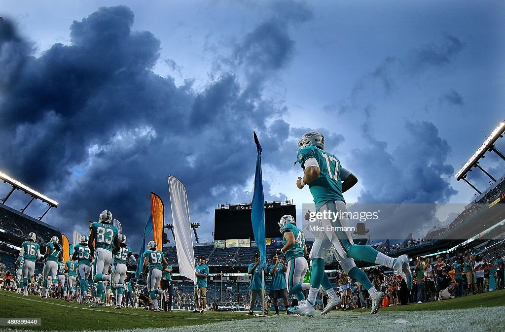 <a gi-track='captionPersonalityLinkClicked' href=/galleries/search?phrase=Ryan+Tannehill&family=editorial&specificpeople=5573174 ng-click='$event.stopPropagation()'>Ryan Tannehill</a> #17 of the Miami Dolphins takes the field during a preseason game against the Tampa Bay Buccaneers at Sun Life Stadium on September 3, 2015 in Miami Gardens, Florida.