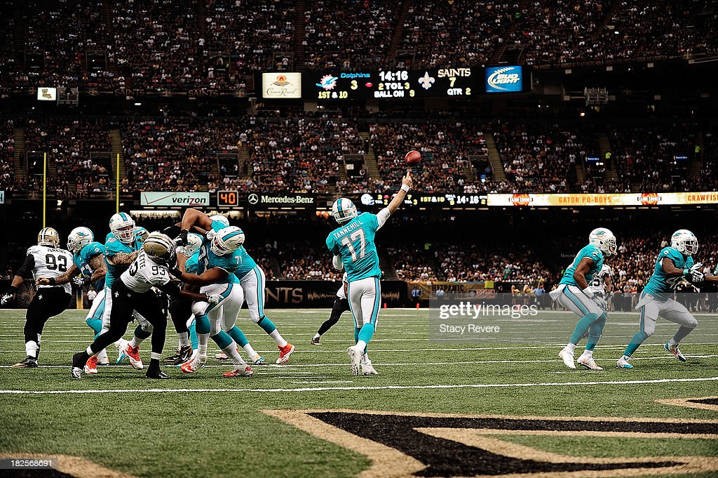 <a gi-track='captionPersonalityLinkClicked' href=/galleries/search?phrase=Ryan+Tannehill&family=editorial&specificpeople=5573174 ng-click='$event.stopPropagation()'>Ryan Tannehill</a> #17 of the Miami Dolphins throws a pass against the New Orleans Saints during a game at the Mercedes-Benz Superdome on September 30, 2013 in New Orleans, Louisiana.