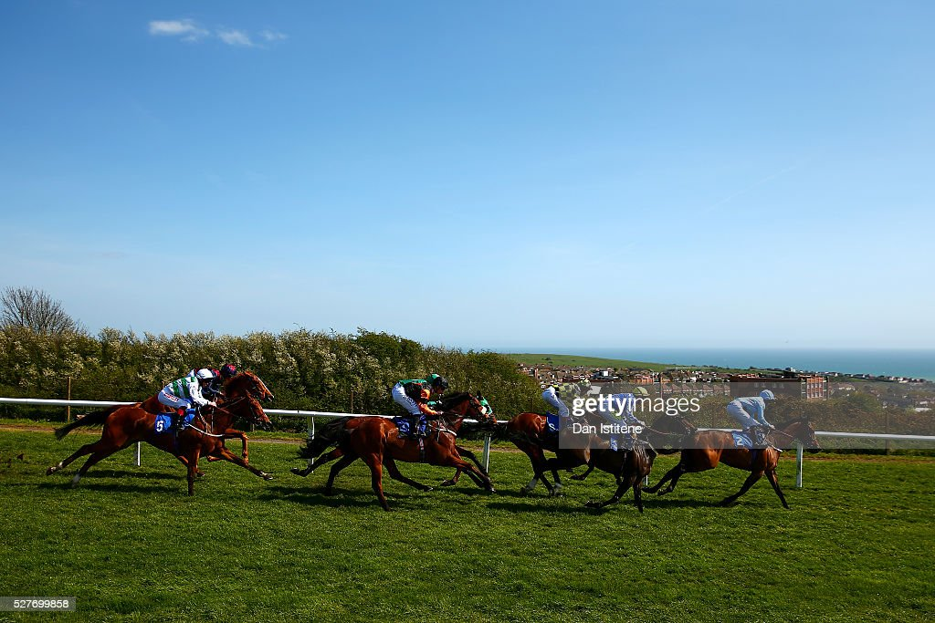 Ryan Tate leads the field riding Ice Slice during the Streamline Taxis - Official Transport Partner Handicap Stakes at Brighton Racecourse on May 3, 2016 in Brighton, England.