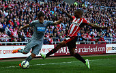Ryan Taylor of Newcastle United and Jermain Defoe of Sunderland compete for the ball during the Barclays Premier League match between Sunderland and...