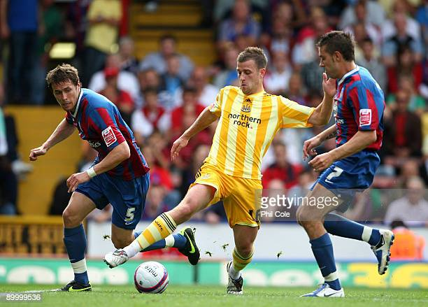 Ryan Taylor of Newcastle United comes under pressure from Darren Ambrose and Patrick McCarthy of Crystal Palace during the CocaCola Championship...