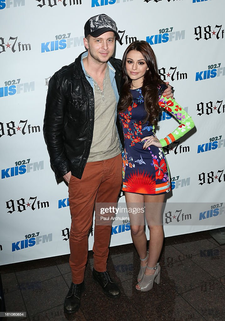 Ryan Tedder (L) and Cher Lloyd (R) attend the 102.7 KIIS FM and 98.7 5th annual celebrity artist lounge celebrating the 55th Annual GRAMMYS at ESPN Zone At L.A. Live on February 8, 2013 in Los Angeles, California.