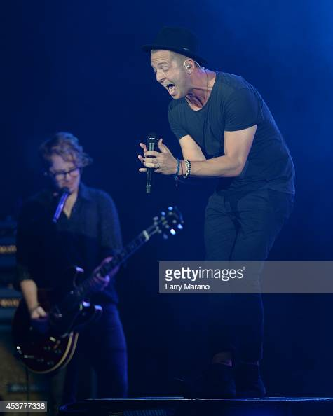 Ryan Tedder and Drew Brown of OneRepublic perform at Cruzan Amphitheatre on August 17 2014 in West Palm Beach Florida