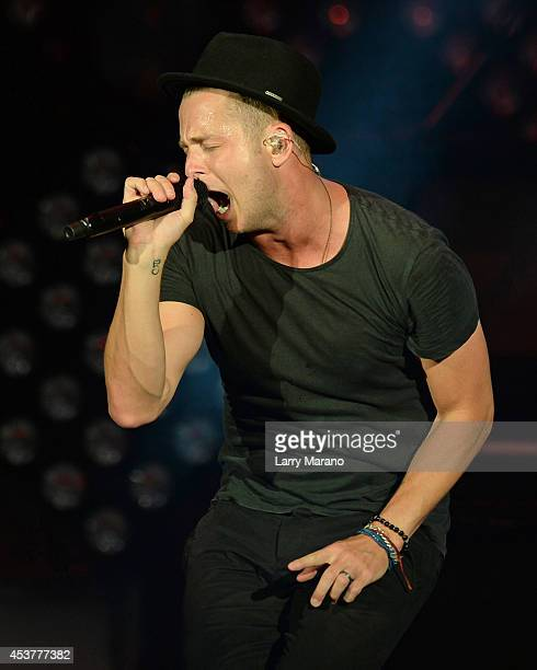 Ryan Tedder of OneRepublic performs at Cruzan Amphitheatre on August 17 2014 in West Palm Beach Florida
