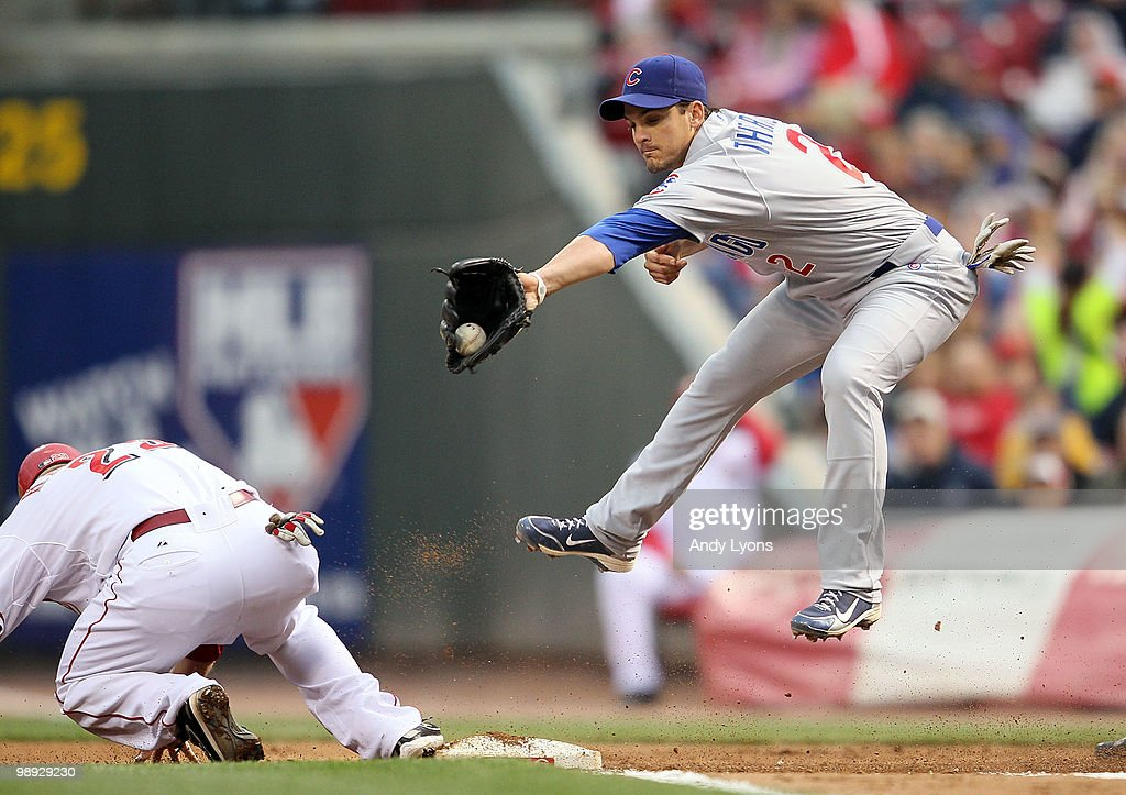 <a gi-track='captionPersonalityLinkClicked' href=/galleries/search?phrase=Ryan+Theriot&family=editorial&specificpeople=796597 ng-click='$event.stopPropagation()'>Ryan Theriot</a> #2 of the Chicago Cubs catches the ball as <a gi-track='captionPersonalityLinkClicked' href=/galleries/search?phrase=Ryan+Hanigan&family=editorial&specificpeople=833982 ng-click='$event.stopPropagation()'>Ryan Hanigan</a> #29 slides safely into first base during the game against the Cincinnati Reds at Great American Ball Park on May 8, 2010 in Cincinnati, Ohio.