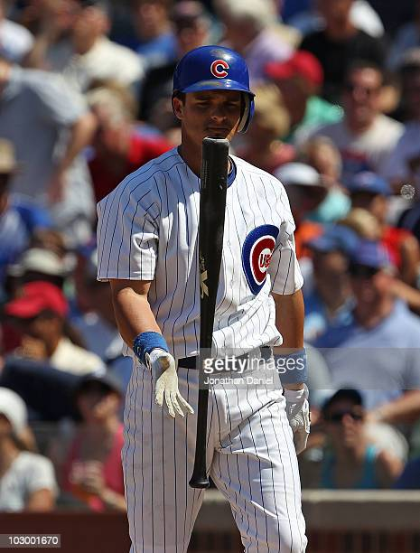Ryan Theriot of the Chicago Cubs flips his bat after striking out against the Philadelphia Phillies at Wrigley Field on July 16 2010 in Chicago...