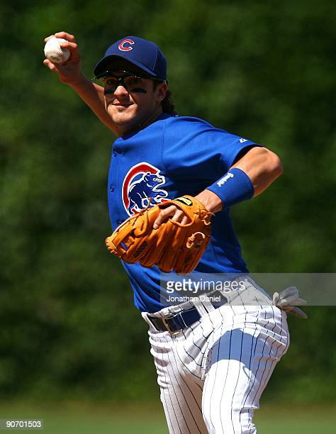 Ryan Theriot of the Chicago Cubs throws to first base during a game against the New York Mets on August 30 2009 at Wrigley Field in Chicago Illinois...