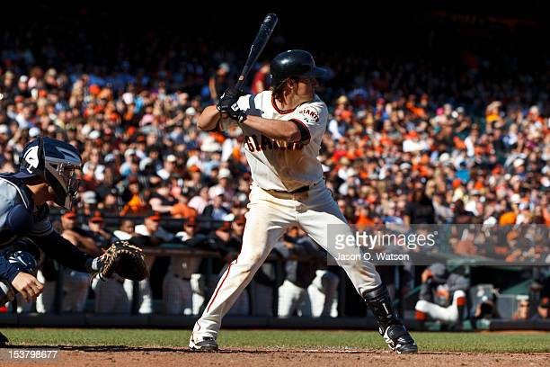 Ryan Theriot of the San Francisco Giants at bat against the San Diego Padres during the eighth inning at ATT Park on September 23 2012 in San...