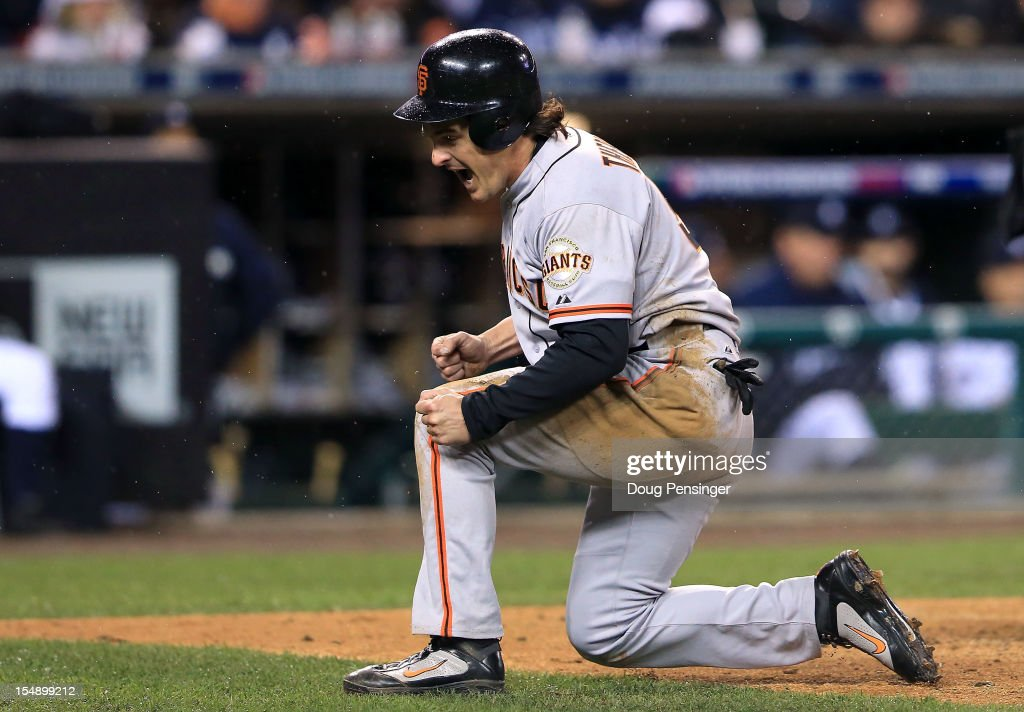 <a gi-track='captionPersonalityLinkClicked' href=/galleries/search?phrase=Ryan+Theriot&family=editorial&specificpeople=796597 ng-click='$event.stopPropagation()'>Ryan Theriot</a> #5 of the San Francisco Giants celebrates after scoring a run off of Marco Scutaro #19 RBI single against Phil Coke #40 of the Detroit Tigers in the tenth inning during Game Four of the Major League Baseball World Series at Comerica Park on October 28, 2012 in Detroit, Michigan.