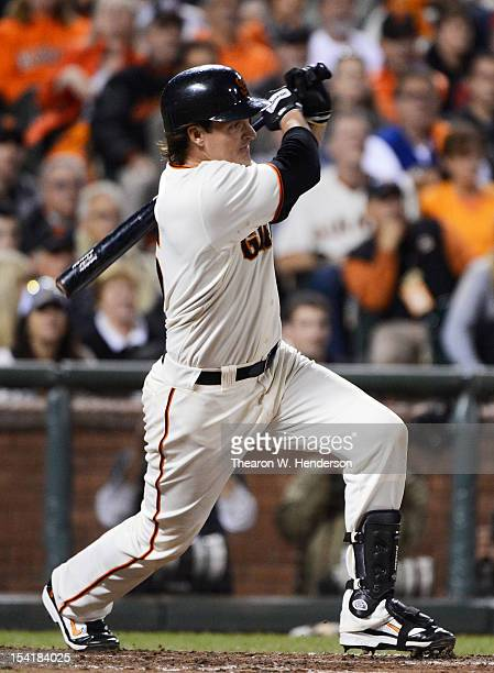 Ryan Theriot of the San Francisco Giants hits a tworun single driving in Gregor Blanco and Aubrey Huff in the eighth inning of Game Two of the...