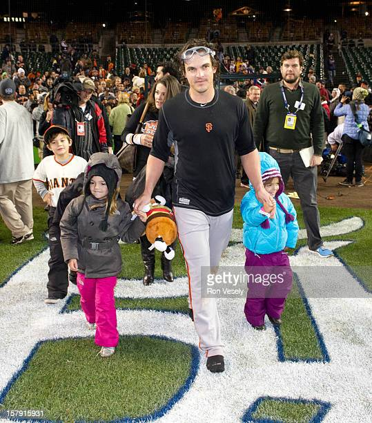 Ryan Theriot of the San Francisco Giants is seen on the field with his daughters after Game 4 of the 2012 World Series against the Detroit Tigers on...