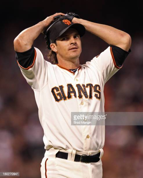 Ryan Theriot of the San Francisco Giants reacts in the third inning as the Washington Nationals scored 7 runs during the game at ATT Park on Monday...