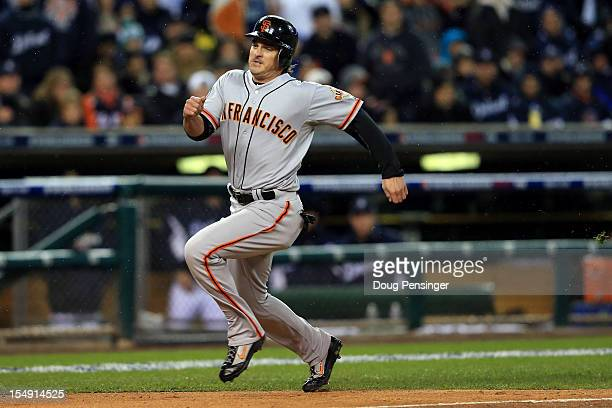 Ryan Theriot of the San Francisco Giants runs home after a run off of Marco Scutaro of the San Francisco Giants an RBI single to center field against...