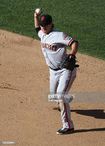 Ryan Theriot of the San Francisco Giants throws to first base during the game against the Oakland Athletics on Saturday June 23 2012 at The Coliseum...