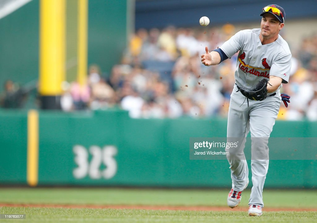 <a gi-track='captionPersonalityLinkClicked' href=/galleries/search?phrase=Ryan+Theriot&family=editorial&specificpeople=796597 ng-click='$event.stopPropagation()'>Ryan Theriot</a> #3 of the St Louis Cardinals misplays a ground ball in the infield against the Pittsburgh Pirates during the game on July 24, 2011 at PNC Park in Pittsburgh, Pennsylvania.