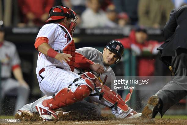 Ryan Theriot of the St Louis Cardinals slides in to home plate safe to scoring the game tying run in the sixth inning of Game Two of the National...