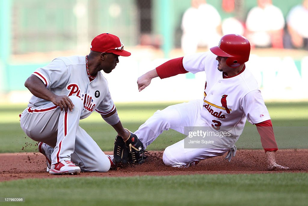 Ryan Theriot #3 of the St. Louis Cardinals steals second base in the fourth inning as Jimmy Rollins #11 of the Philadelphia Phillies tries for the tag during Game Three of the National League Division Series at Busch Stadium on October 4, 2011 in St Louis, Missouri.