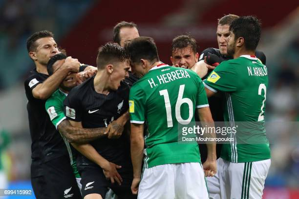Ryan Thomas of New Zealand and Hector Herrera of Mexico clash during the FIFA Confederations Cup Russia 2017 Group A match between Mexico and New...