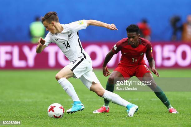 Ryan Thomas of New Zealand attempts to get past Nelson Semedo of Portugal during the FIFA Confederations Cup Russia 2017 Group A match between New...