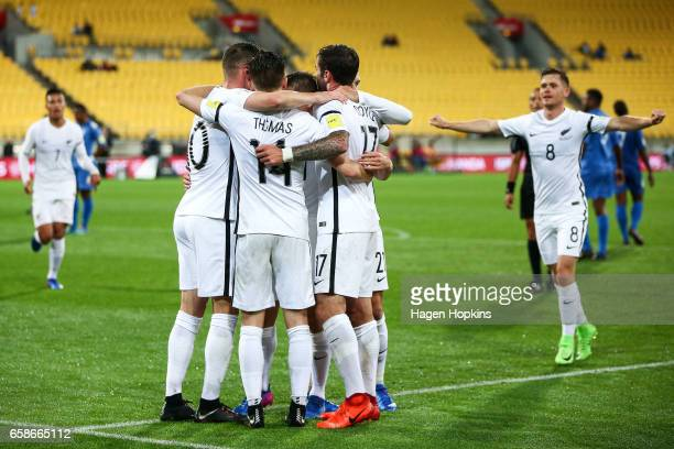 Ryan Thomas of New Zealand celebrates with teammates after scoring a goal during the 2018 FIFA World Cup Qualifier match between the New Zealand All...