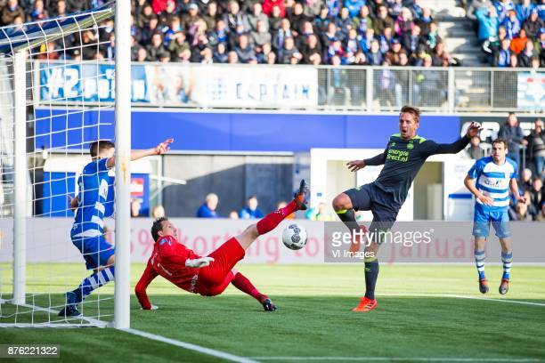 Ryan Thomas of PEC Zwolle goalkeeper Diederik Boer of PEC Zwolle Luuk de Jong of PSV Dirk Marcellis of PEC Zwolle during the Dutch Eredivisie match...