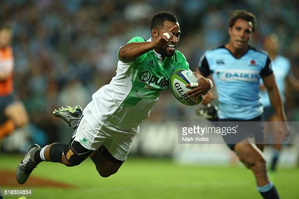 Ryan Tongia of the Highlanders dives over to score a try during the Super Rugby match between the New South Wales Waratahs and the Highlanders at...