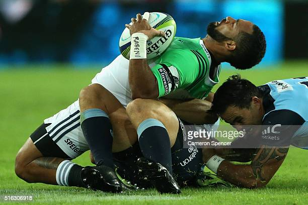 Ryan Tongia of the Highlanders is tackled during the Super Rugby match between the New South Wales Waratahs and the Highlanders at Allianz Stadium on...