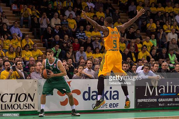 Ryan Toolson #9 of Unicaja Malaga competes with Jamar Smith #5 of Limoges CSP during the 20142015 Turkish Airlines Euroleague Basketball Regular...