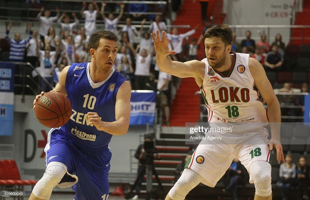 Ryan Toolson (L) of Zenit St.-Petersburg in action against Evgeny Voronov (R) of Lokomotiv-Kuban Krasnodar during VTB-League basketball match between Zenit St.Petersburg and Lokomotiv-Kuban Krasnodar at the SIBUR Arena in Saint-Petersburg , Russia on April 28, 2016.