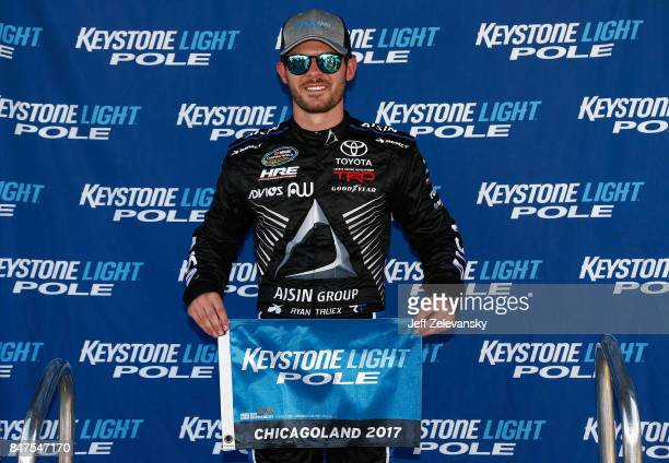 Ryan Truex driver of the ADVICS/AISIN Toyota poses with the Keystone Light Pole Award after qualifying in the pole position for the NASCAR Camping...