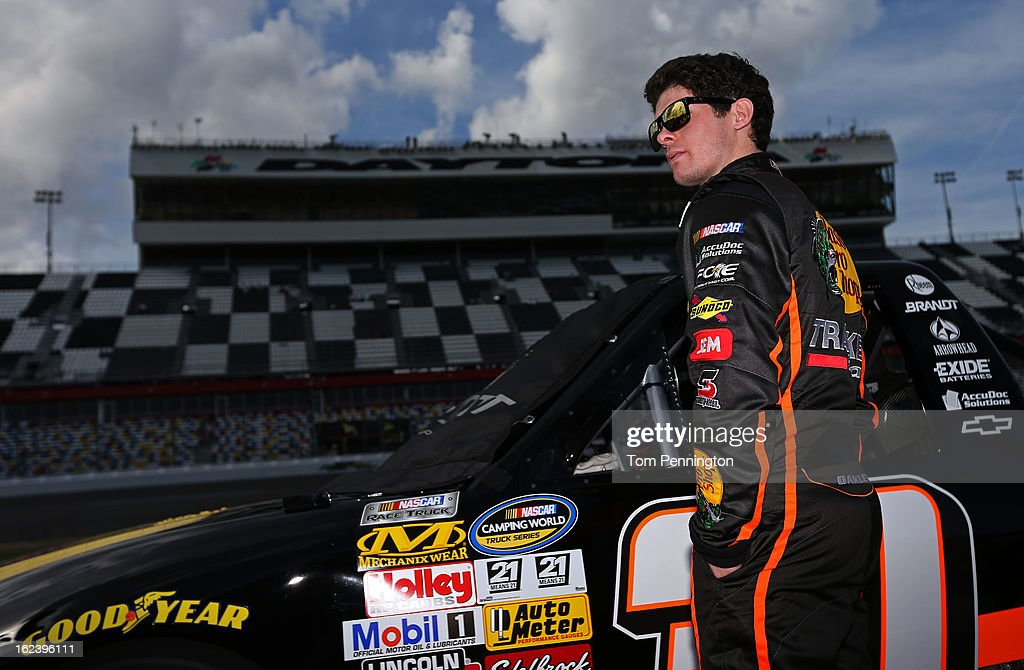 <a gi-track='captionPersonalityLinkClicked' href=/galleries/search?phrase=Ryan+Truex&family=editorial&specificpeople=5943617 ng-click='$event.stopPropagation()'>Ryan Truex</a>, driver of the #30 Bass Pro Shops Chevrolet, stands on the grid during qualifying for the NASCAR Camping World Truck Series NextEra Energy Resources 250 at Daytona International Speedway on February 22, 2013 in Daytona Beach, Florida.