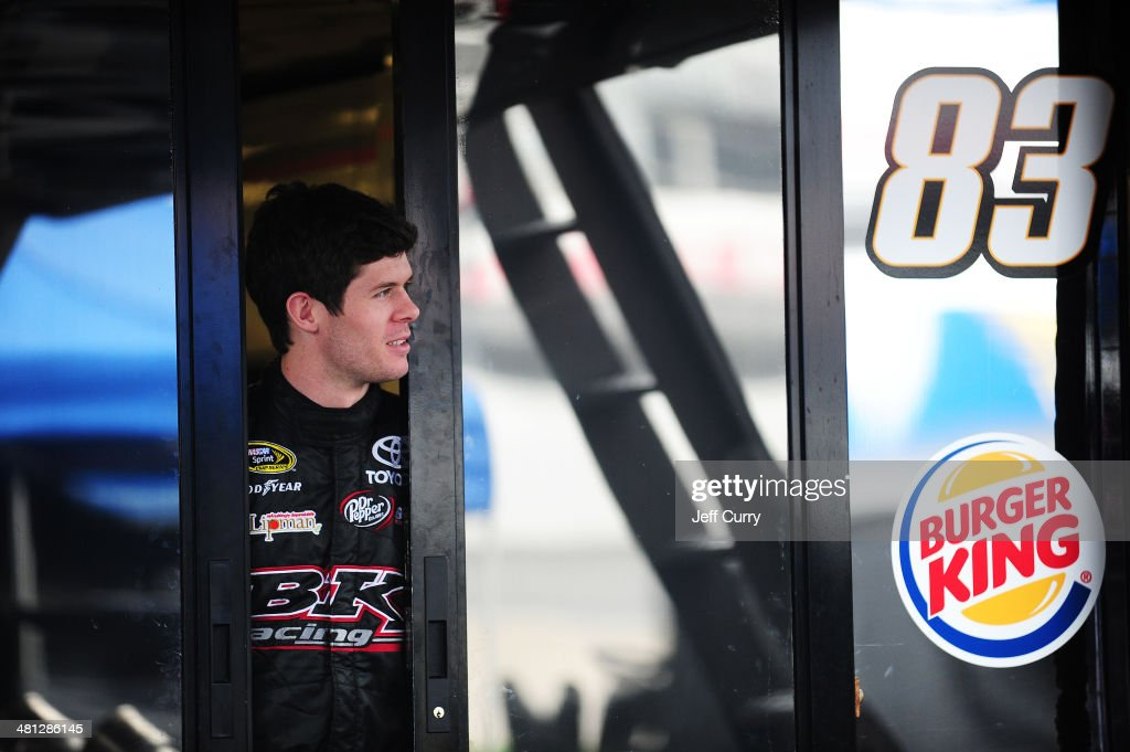 <a gi-track='captionPersonalityLinkClicked' href=/galleries/search?phrase=Ryan+Truex&family=editorial&specificpeople=5943617 ng-click='$event.stopPropagation()'>Ryan Truex</a>, driver of the #83 Borla Exhaust Toyota, looks out of his car transporter during a rain delay in practice for the NASCAR Sprint Cup Series STP 500 at Martinsville Speedway on March 29, 2014 in Martinsville, Virginia.