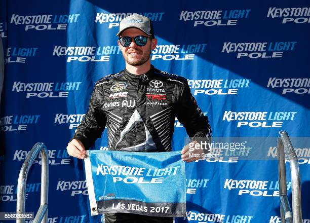 Ryan Truex driver of the Martin Truex Jr Foundation Toyota poses with the Keystone Light Pole award after qualifying for the NASCAR Camping World...