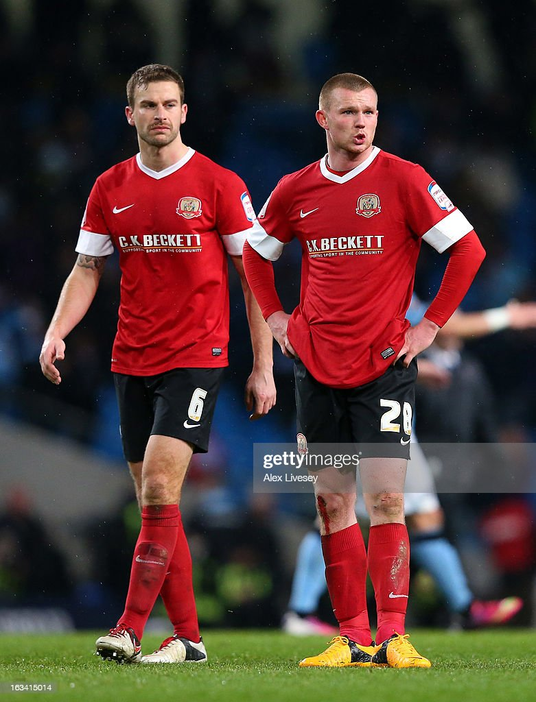 <a gi-track='captionPersonalityLinkClicked' href=/galleries/search?phrase=Ryan+Tunnicliffe&family=editorial&specificpeople=5848106 ng-click='$event.stopPropagation()'>Ryan Tunnicliffe</a> and Stephen Foster of Barnsley look dejected at the final whistle after the FA Cup sponsored by Budweiser sixth round match between Manchester City and Barnsley at Etihad Stadium on March 9, 2013 in Manchester, England.