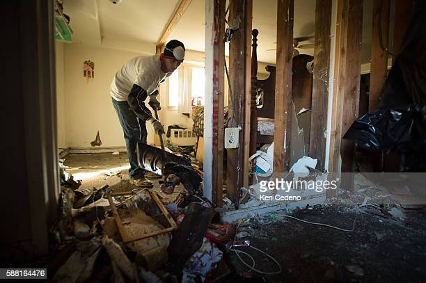 Ryan Valli uses a snow shovel to clean up their home that were severely affected by Superstorm Sandy in Union Beach NJ November 3 2012 Photo Ken...