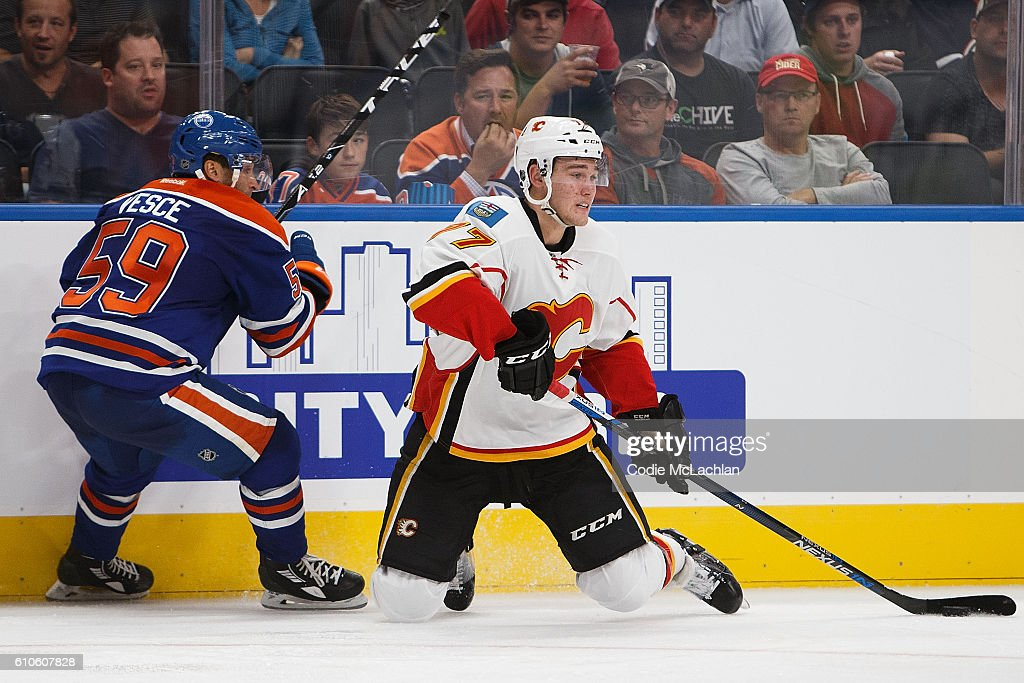 Ryan Vesce #59 of the Edmonton Oilers looks on as Mark Jankowski #77 of the Calgary Flames makes a pass in an NHL preseason game on September 26, 2016 at Rogers Place in Edmonton, Alberta, Canada.