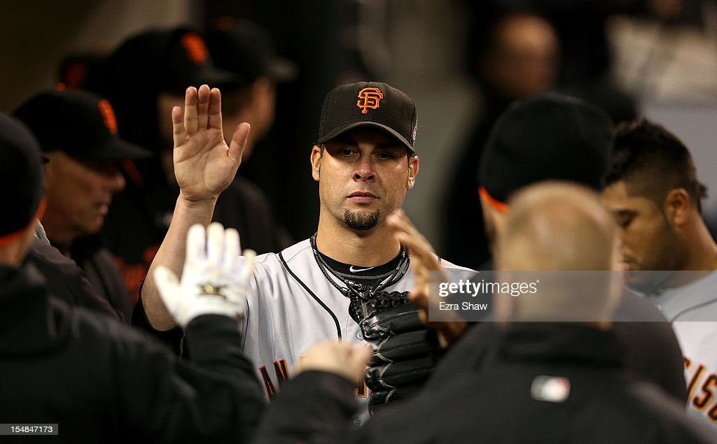 <a gi-track='captionPersonalityLinkClicked' href=/galleries/search?phrase=Ryan+Vogelsong&family=editorial&specificpeople=670011 ng-click='$event.stopPropagation()'>Ryan Vogelsong</a> #32 of the San Francisco Giants high-fives his teammates in the dugout after being relieved by Tim Lincecum #55 in the sixth inning against the Detroit Tigers during Game Three of the Major League Baseball World Series at Comerica Park on October 27, 2012 in Detroit, Michigan.