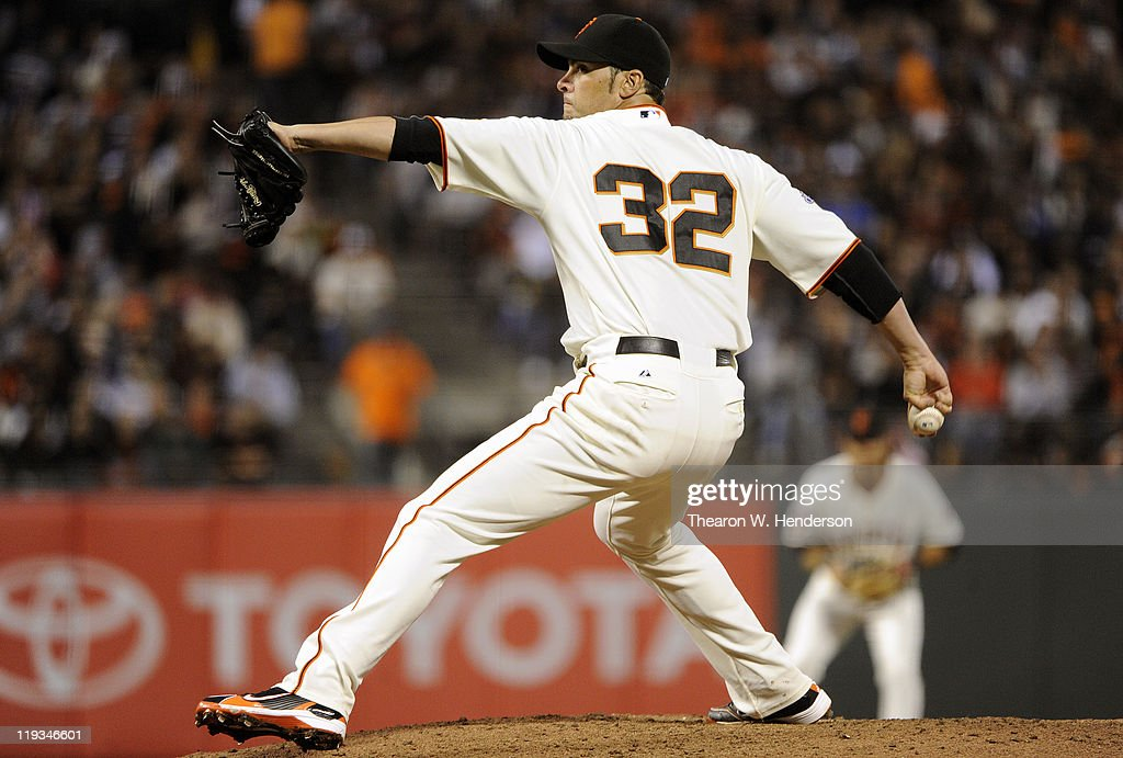 <a gi-track='captionPersonalityLinkClicked' href=/galleries/search?phrase=Ryan+Vogelsong&family=editorial&specificpeople=670011 ng-click='$event.stopPropagation()'>Ryan Vogelsong</a> #32 of the San Francisco Giants pitches against the Los Angeles Dodgers in the fifth inning during an MLB baseball game at AT&T Park July 18, 2011 in San Francisco, California.