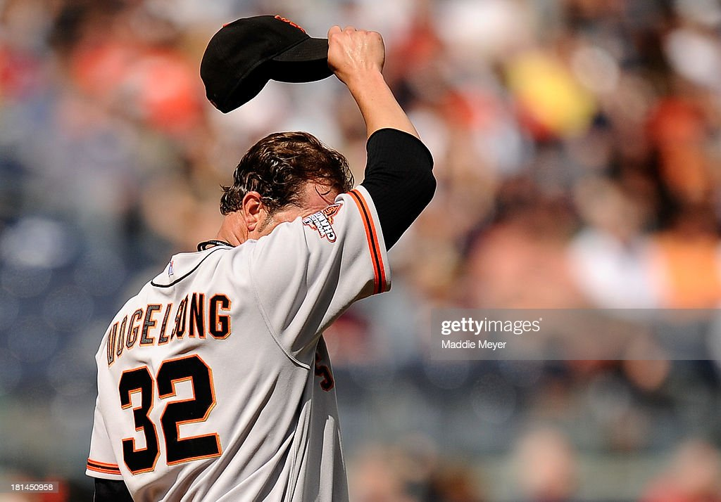 <a gi-track='captionPersonalityLinkClicked' href=/galleries/search?phrase=Ryan+Vogelsong&family=editorial&specificpeople=670011 ng-click='$event.stopPropagation()'>Ryan Vogelsong</a> #32 of the San Francisco Giants reacts after walking Chris Stewart #19 of the New York Yankees in the third inning during interleague play on September 21, 2013 at Yankee Stadium in the Bronx borough of New York City.