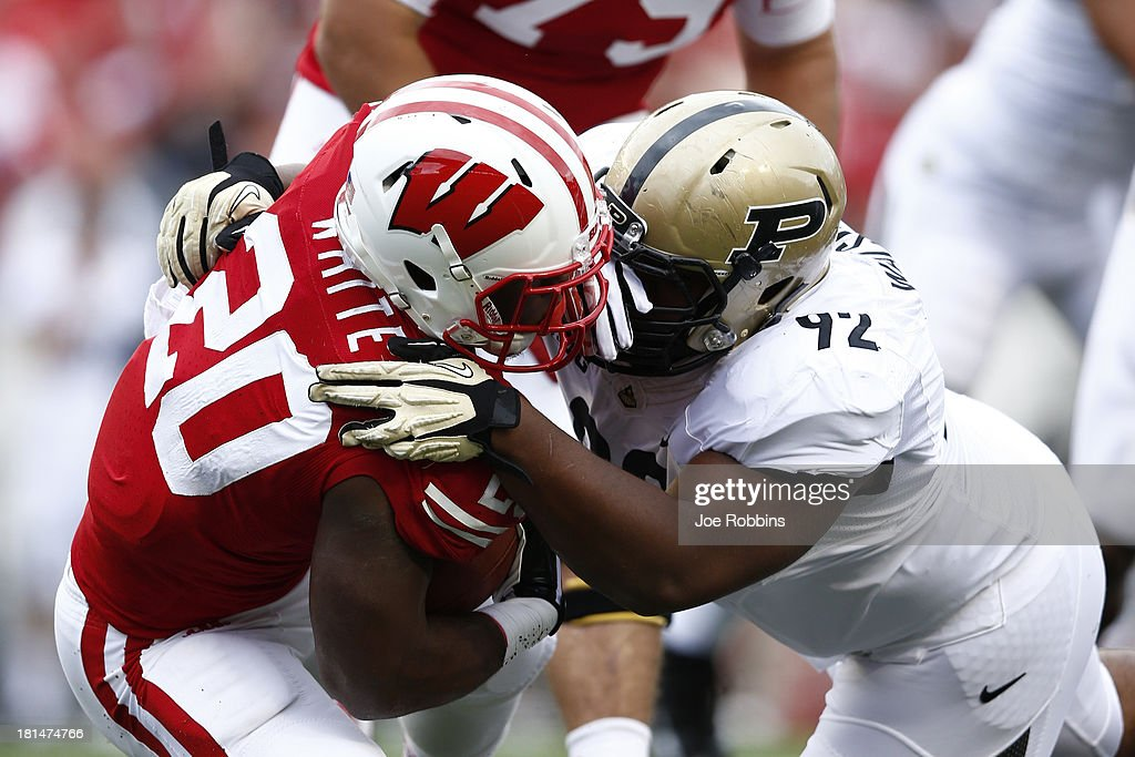 Ryan Watson #92 of the Purdue Boilermakers makes a tackle against James White #20 of the Wisconsin Badgers during the game at Camp Randall Stadium on September 21, 2013 in Madison, Wisconsin.