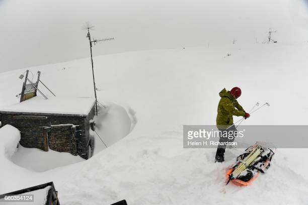 Ryan Webb a post doctoral fellow with CU and the Institute of Arctic and Alpine Research gets his skis and sled ready to head towards the 2nd of 3...