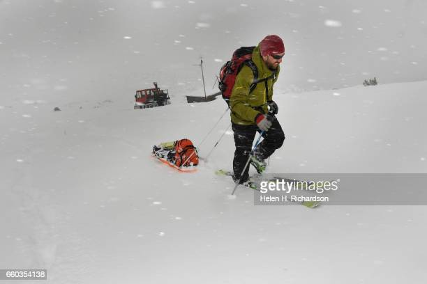 Ryan Webb a post doctoral fellow with CU and the Institute of Arctic and Alpine Research battling fierce winds and snowfall heads towards the 2nd of...