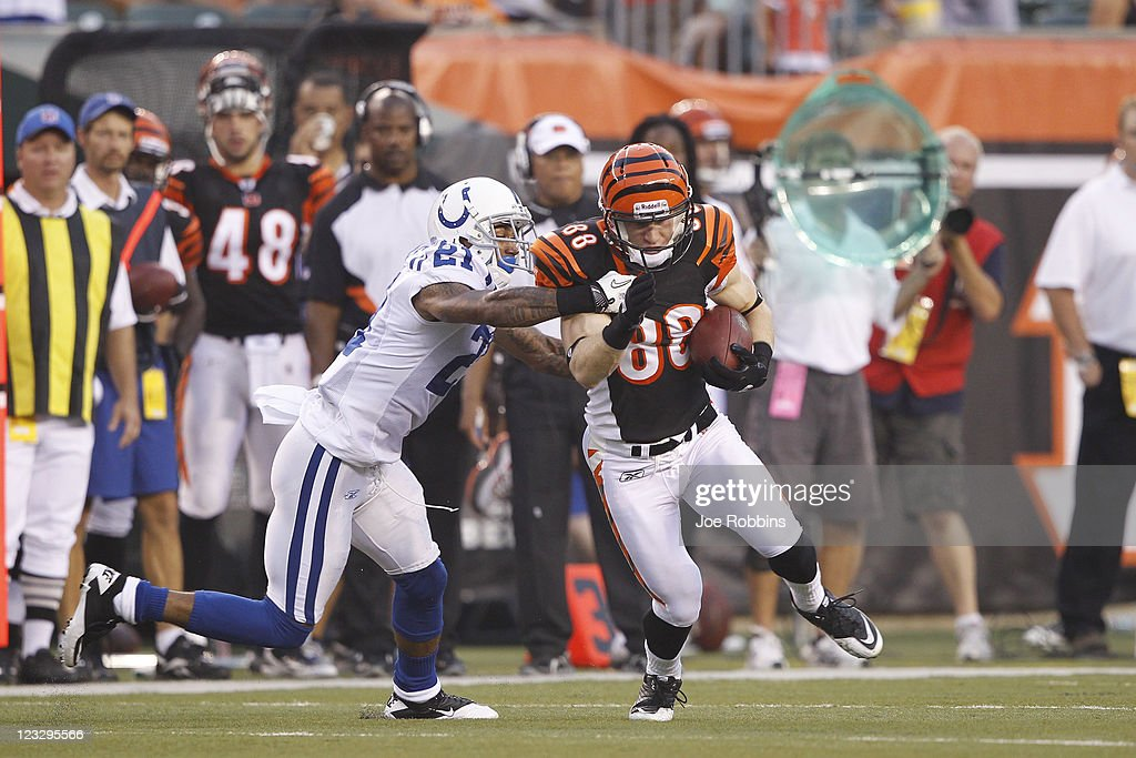 Ryan Whalen #88 of the Cincinnati Bengals makes a move after a reception against Kevin Thomas #21 of the Indianapolis Colts during an NFL preseason game at Paul Brown Stadium on September 1, 2011 in Cincinnati, Ohio. The Colts won 17-13.