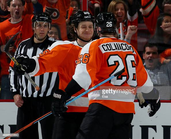 Ryan White congratulates teammate Carlo Colaiacovo of the Philadelphia Flyers after he scored in the third period against the New York Islanders on...
