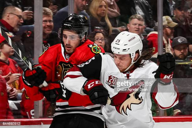 Ryan White of the Arizona Coyotes hits Nick Schmaltz of the Chicago Blackhawks in the first period at the United Center on February 23 2017 in...